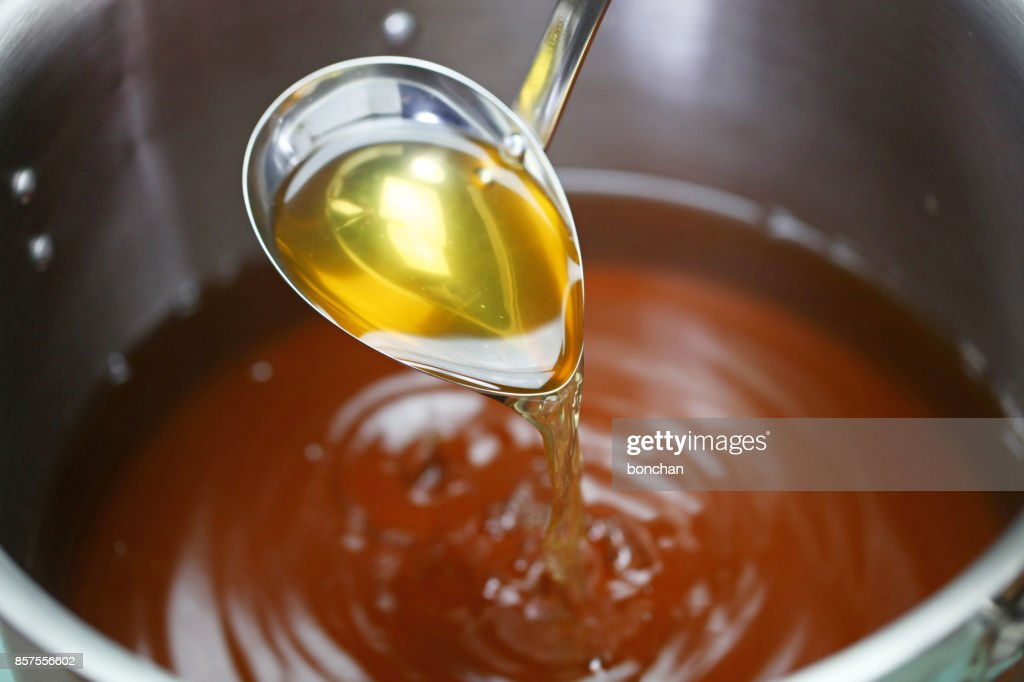 making chicken consomme soup in a pot : Stock Photo