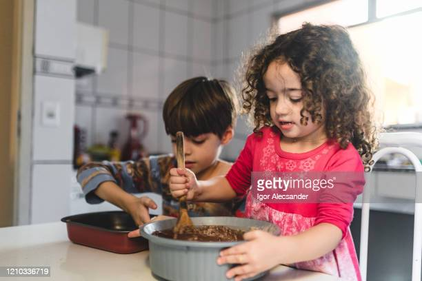 making chocolate cake in the morning - easter sunday stock pictures, royalty-free photos & images