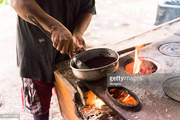 making chocolate from cacao superfood in cahuita costa rica - chocolate factory bildbanksfoton och bilder