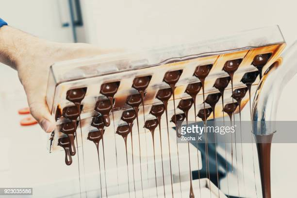 making chocolate - chocolate factory stock photos and pictures