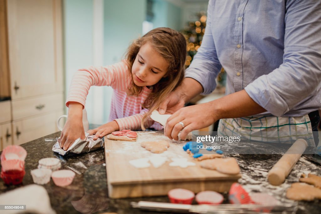 Making Christmas Biscuits With Dad : Stock Photo