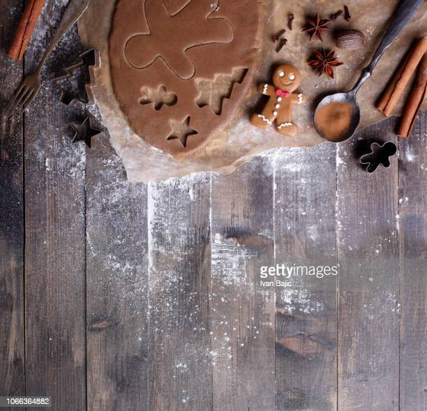 making christmas cookies - gingerbread man stock photos and pictures