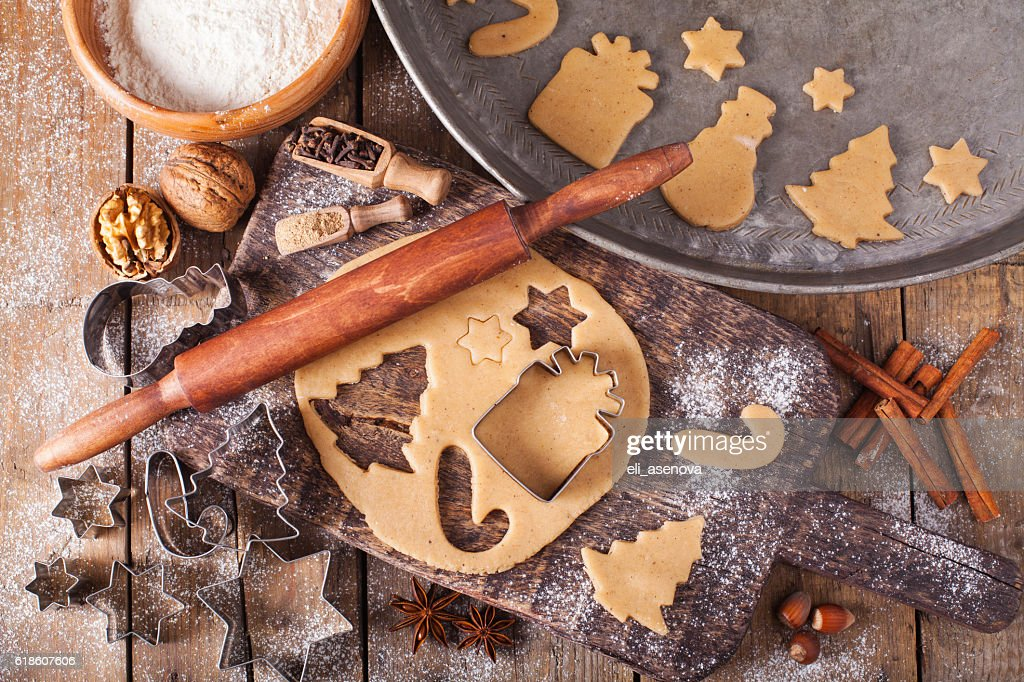 Making Christmas Cookies with traditional gingerbread cookies ingredients : Stock Photo