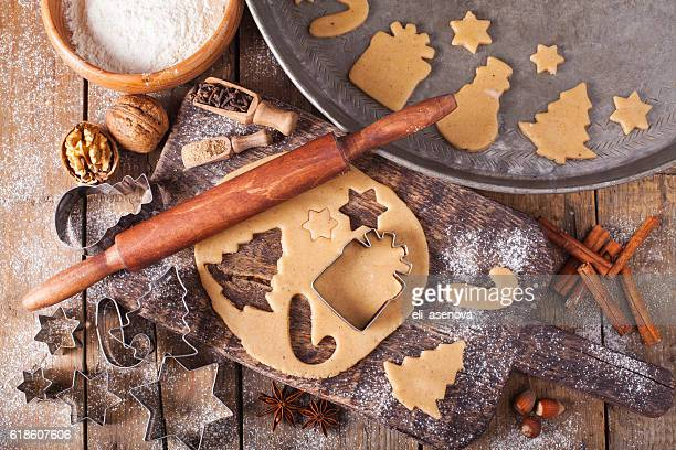 making christmas cookies with traditional gingerbread cookies ingredients - nut food stock photos and pictures