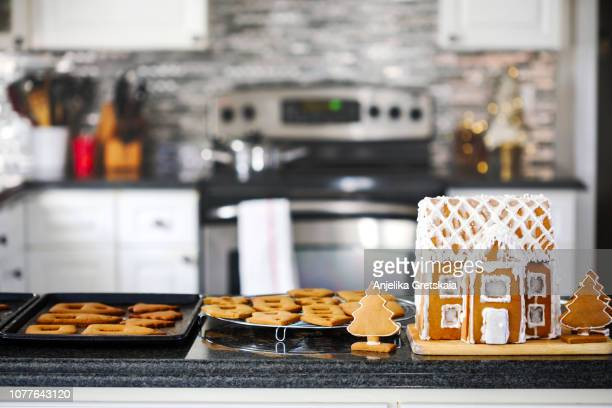 making christmas gingerbread house and cookies. - kitchen background stock pictures, royalty-free photos & images