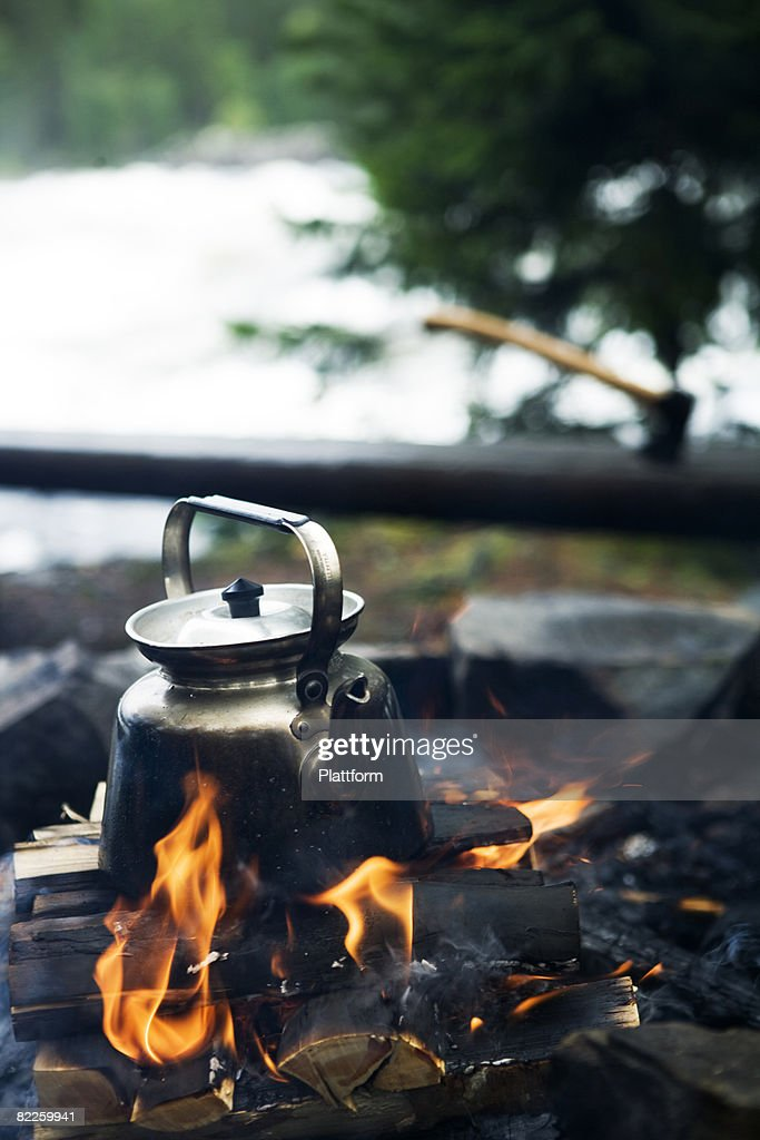 Making coffee over a camp fire Sweden. : Stock Photo