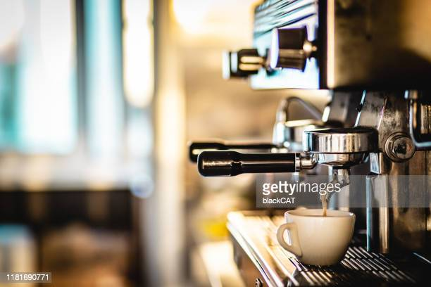 making coffee with espresso machine - espresso stock pictures, royalty-free photos & images