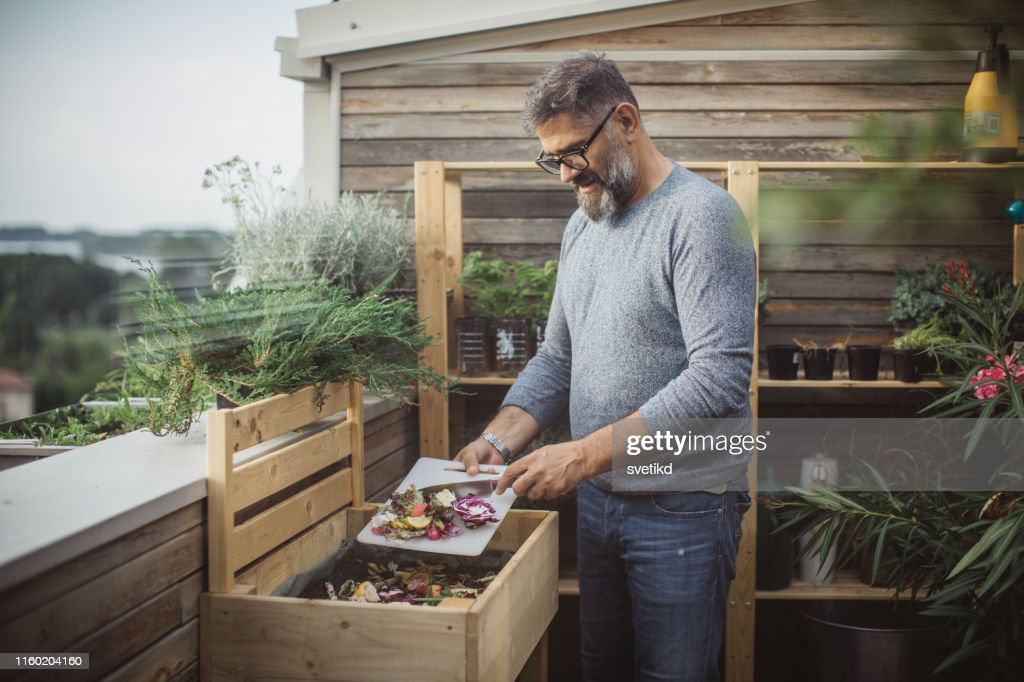 Making compost from leftovers : Stock Photo