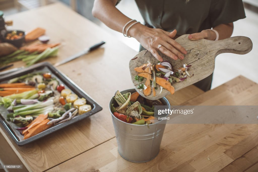 Making compost from vegetable leftovers : Stock Photo