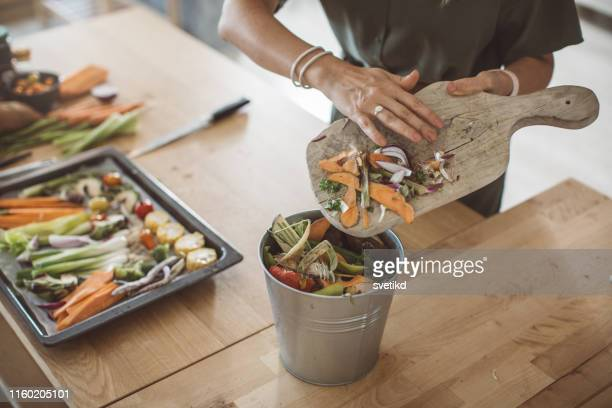 making compost from vegetable leftovers - food and drink stock pictures, royalty-free photos & images