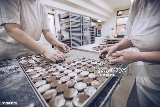 making cookies - chocolate factory stock photos and pictures