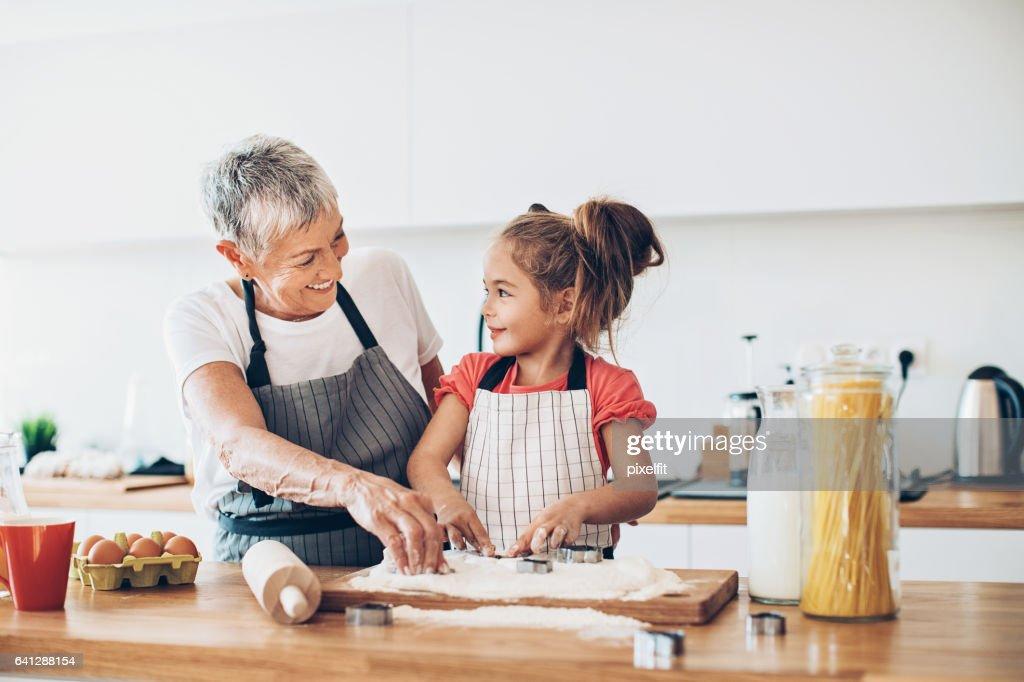 Making cookies with grandma : Stock Photo