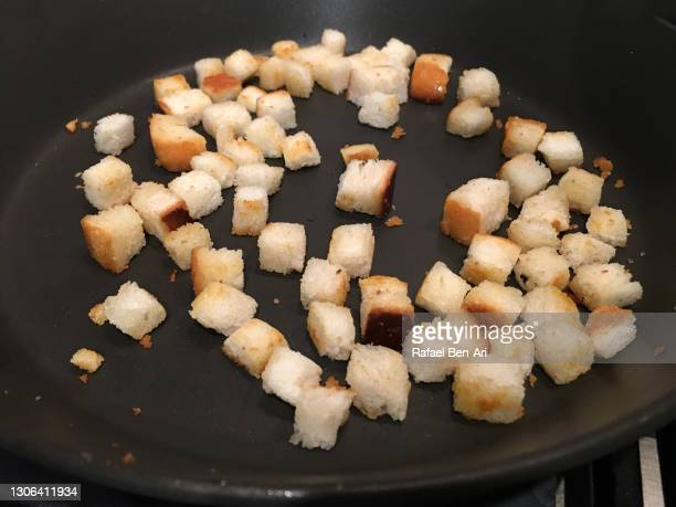 making croutons from sliced bread - rafael ben ari stock pictures, royalty-free photos & images