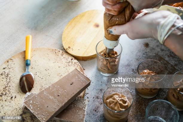 making dessert's - chocolate mousse stock pictures, royalty-free photos & images