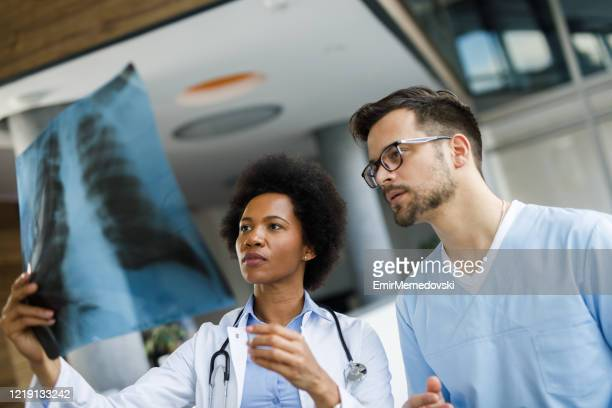 making diagnosis a team task - tomography stock pictures, royalty-free photos & images