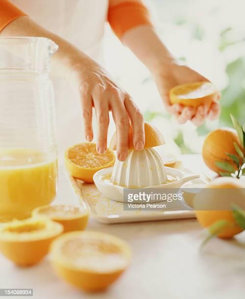 Making freshly-squeezed orange juice.