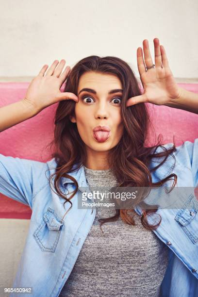 making funny faces and loving it - one young woman only stock pictures, royalty-free photos & images