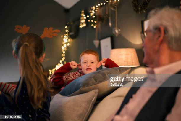 making funny faces - christmas stock pictures, royalty-free photos & images