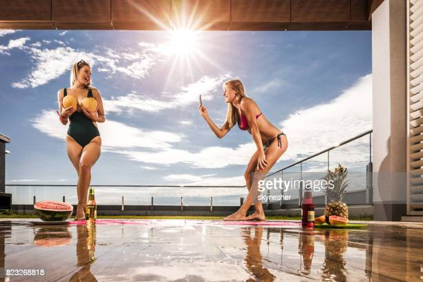 making funny photos during summer day on a terrace! - women of penthouse stock photos and pictures