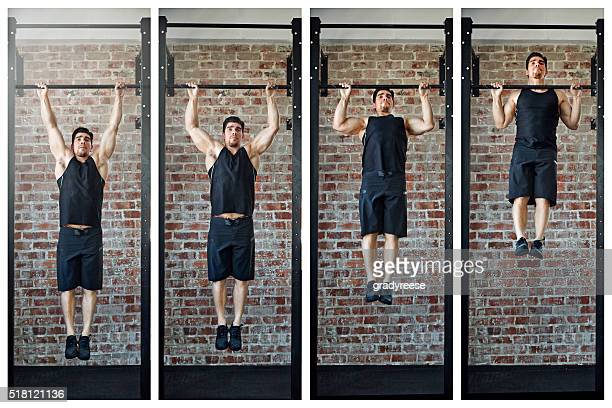 making gains - chin ups stock photos and pictures