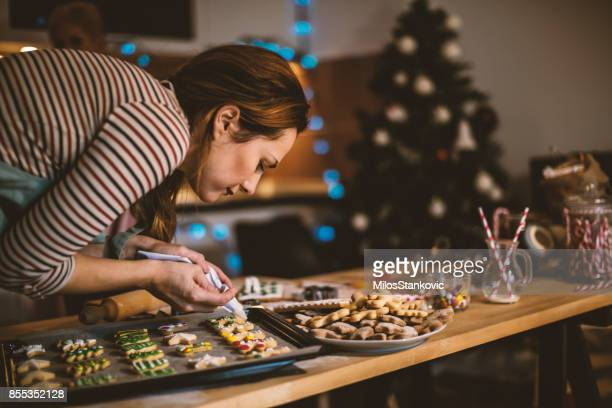 making gingerbread cookies for christmas - decoration stock pictures, royalty-free photos & images