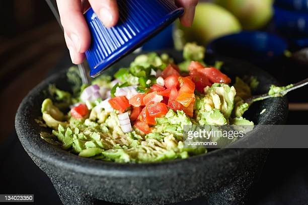 making guacamole - guacamole stock photos and pictures