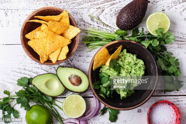 making guacamole sauce, mexican cuisine ingredients - guacamole stock pictures, royalty-free photos & images