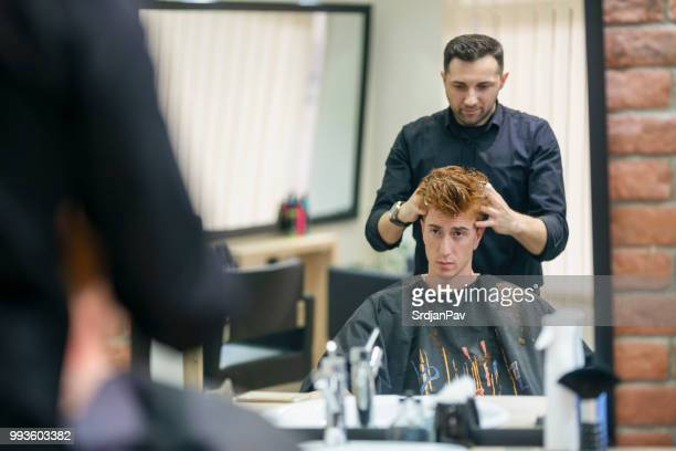 making haircut with hair mousse - hair conditioner stock photos and pictures