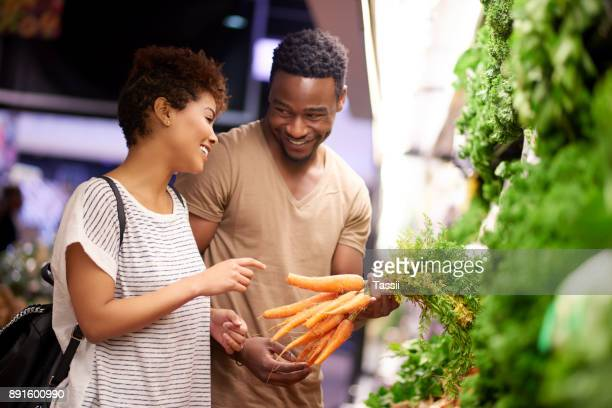 making healthy choices together - market retail space stock photos and pictures