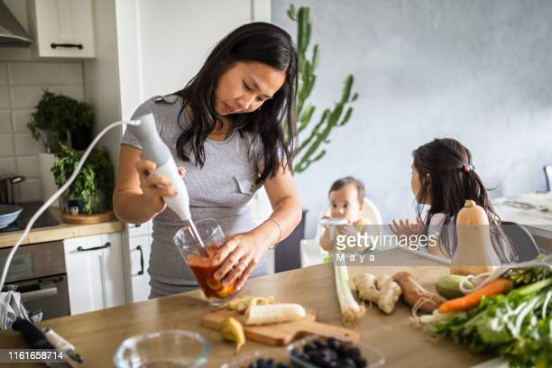 making healthy fruits meal for baby - baby m stock pictures, royalty-free photos & images