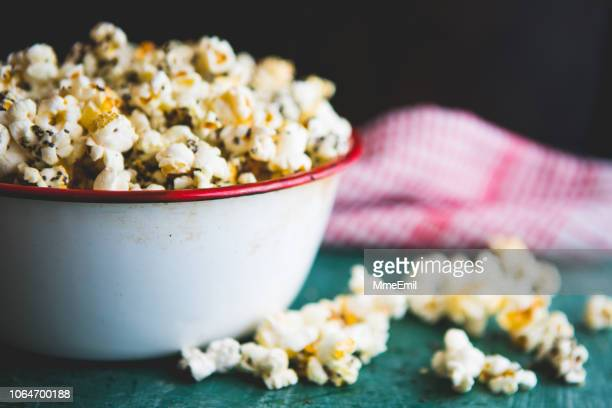 making healthy popcorn at home - popcorn stock pictures, royalty-free photos & images