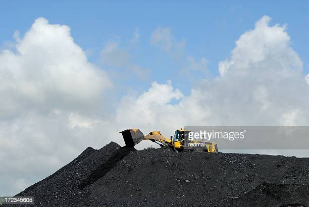 making heaps - coal mining stock photos and pictures