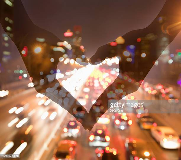 Making Heart Sign with Hands, Night View