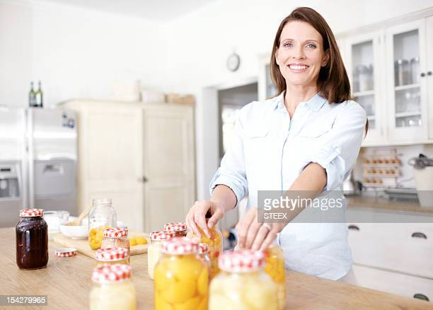 Making her famous preserved fruit