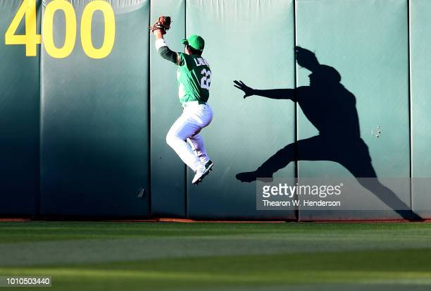Making his magor league debut Ramon Laureano of the Oakland Athletics leaps at the wall to take a hit away from Nicholas Castellanos of the Detroit...