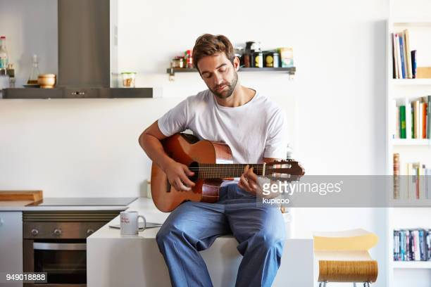 making his mornings musical - plucking an instrument stock pictures, royalty-free photos & images