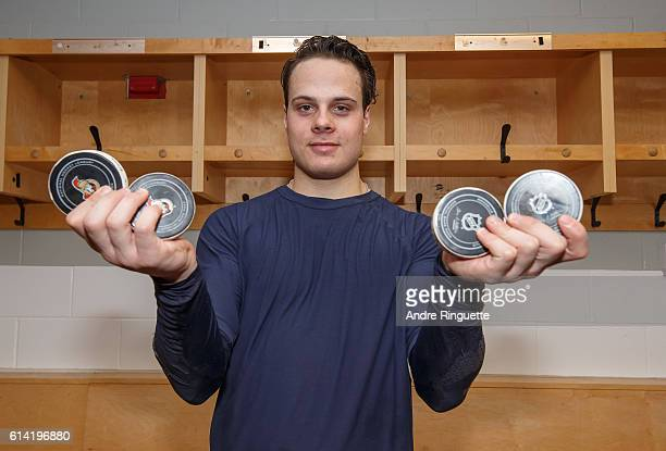 Making his NHL debut Auston Matthews of the Toronto Maple Leafs poses with the 4 pucks with which he scored his first career NHL goals after a game...