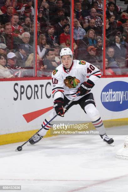 Making his NHL debut John Hayden of the Chicago Blackhawks skates with the puck against the Ottawa Senators at Canadian Tire Centre on March 16 2017...