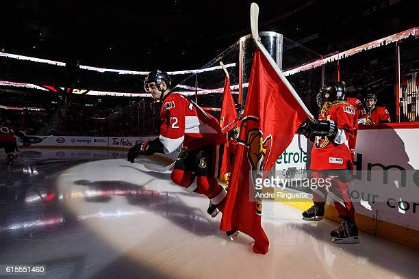 Making his NHL debut Thomas Chabot of the Ottawa Senators steps onto the ice during player introductions prior to a game against the Arizona Coyotes...