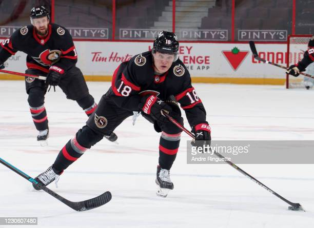 Making his NHL debut, Tim Stützle of the Ottawa Senators skates up ice with the puck against the Toronto Maple Leafs at Canadian Tire Centre on...