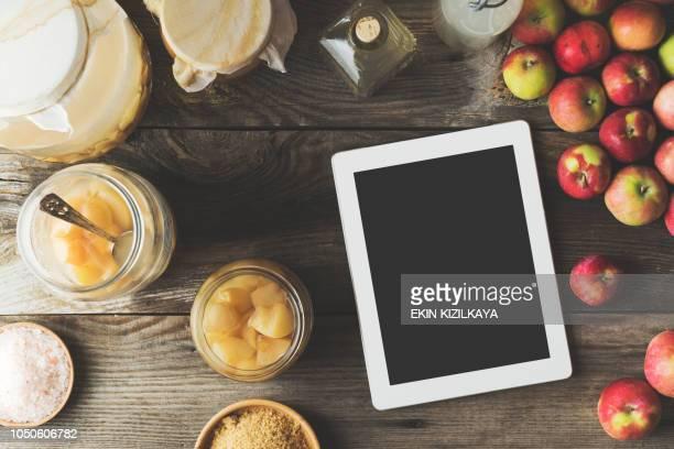 Making homemade apple cider vinegar, digital tablet on table
