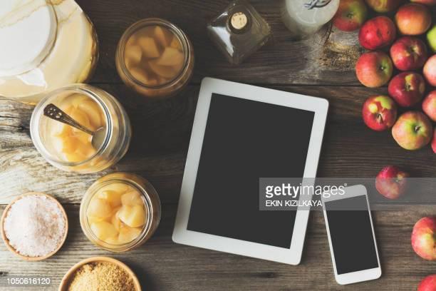 Making homemade apple cider vinegar, mobile devices on table