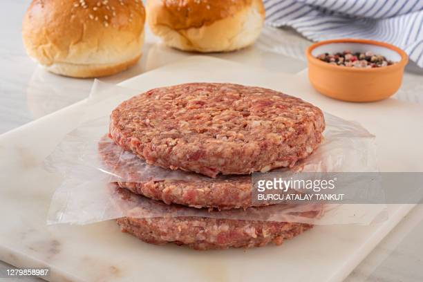 making homemade burgers - raw food stock pictures, royalty-free photos & images