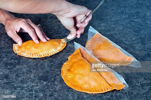 making homemade empanadas - empanada stock pictures, royalty-free photos & images