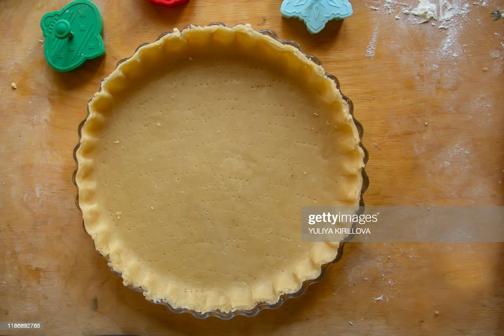 making homemade shortcrust pastry for pies and cookies : Stock Photo