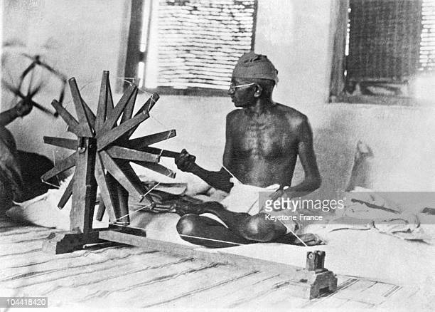 GANDHI making homespun cotton or kadhi by using a spinning wheel called a chakra to boycott English merchandise and to boost economic selfsufficiency...
