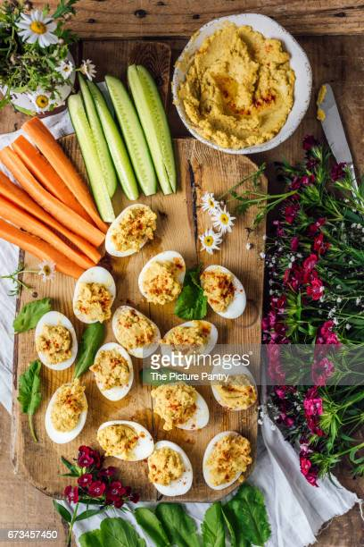 Making hummus deviled eggs