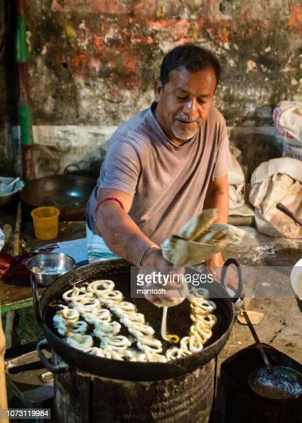 making jalebi sweet. - temptation stock pictures, royalty-free photos & images