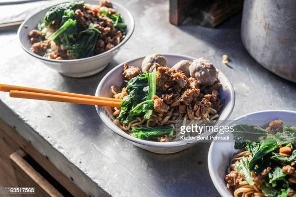 making javanese chicken noodles, the best noodles in town - yogyakarta stock pictures, royalty-free photos & images
