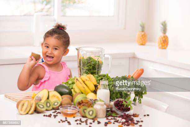 making juices is fun. 2-3 years old assistant in the kitchen. - mint plant family stock pictures, royalty-free photos & images